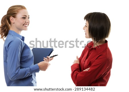 Two business woman chatting away together