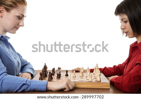 two business woman playing chess together trying to out think each other