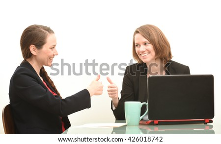 Two business women and thumbs up - stock photo