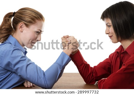 Two business women arm wrestling each other
