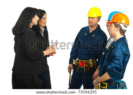 Two business women having conversation with workers team  isolated on white background - stock photo