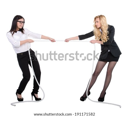 Two business women in competition pulling rope isolated on white background - stock photo