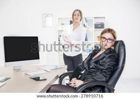 Two business women in office. Boss and employer - stock photo