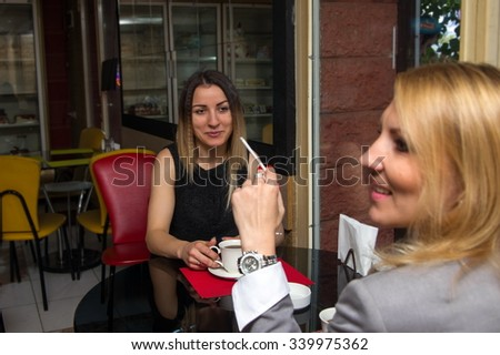 two business women in old cafe having a chat