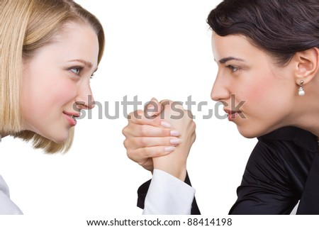 Two business women look at each other's eyes, isolated on white background - stock photo