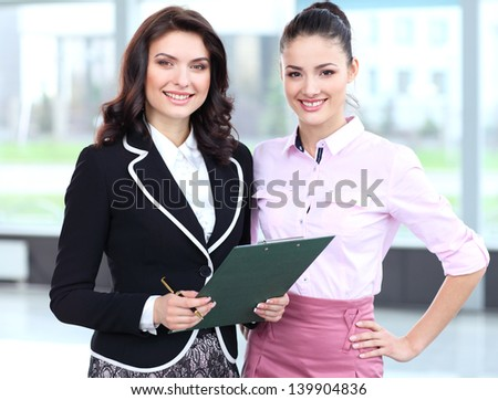 Two business women team at office building - stock photo