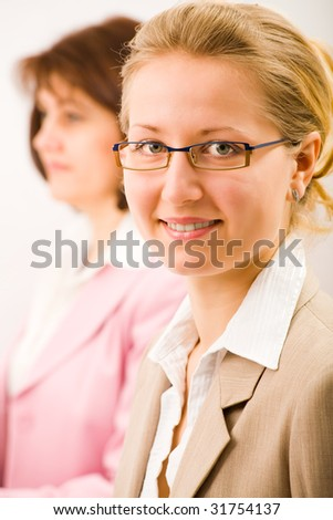 two business women working in the office - stock photo