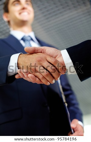 Two businessman happily shaking hands indicating successful negotiations - stock photo