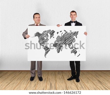two businessman holding poster with world map - stock photo