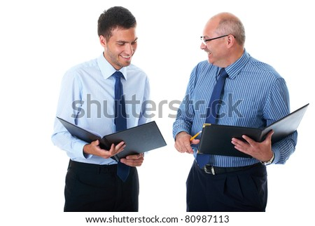 two businessman in blue shirts check and discuss their documents, isolated on white