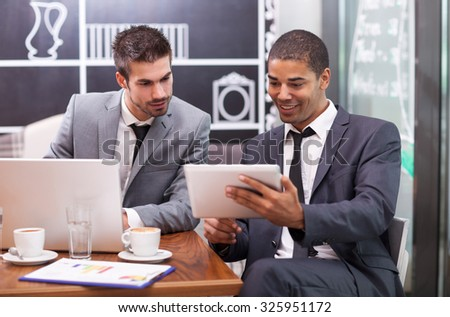 two businessman on a break in a cafe thinking about future actions - stock photo