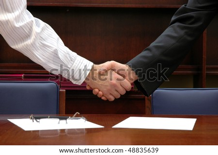 Two businessman shaking hands after deal, business concept