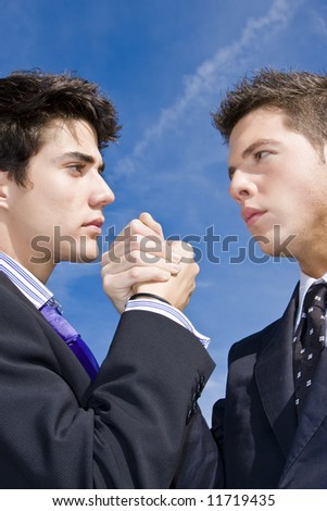 Two businessman showing agreement or competition. - stock photo