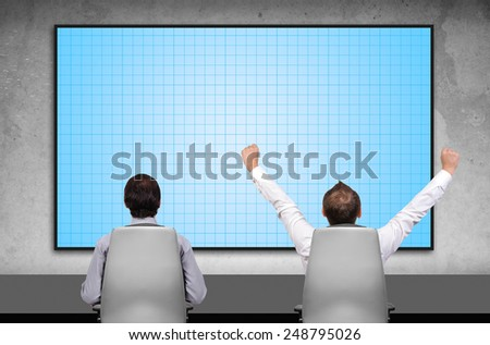 two businessman sitting in office and looking to blank plasma panel - stock photo