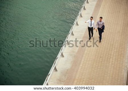 Two businessman walking and sightseeing in Dubai. - stock photo