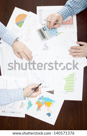 Two businessmen analyzing some financial data at the desk - stock photo