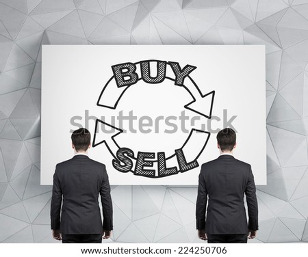 Two Businessmen and a choice 'sell or buy' concept.  - stock photo