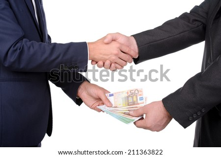 Two businessmen and paying money, isolated on white - stock photo