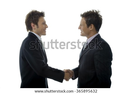 Two businessmen are making a sincere handshake to celebrate new partnership. Isolated on white background.