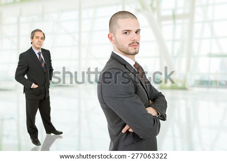 two businessmen at the office - stock photo
