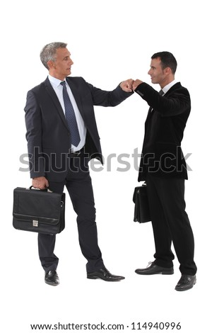 Two businessmen bumping fists - stock photo
