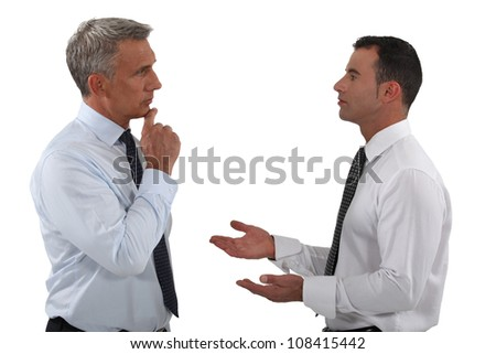 Two businessmen discussing. - stock photo