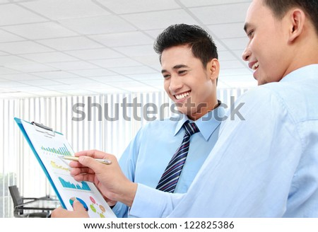 Two businessmen discussing a business chart growth - stock photo