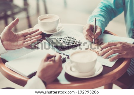 Two businessmen discussing some project - stock photo