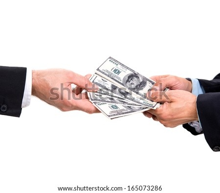 Two businessmen giving and taking dollars - stock photo