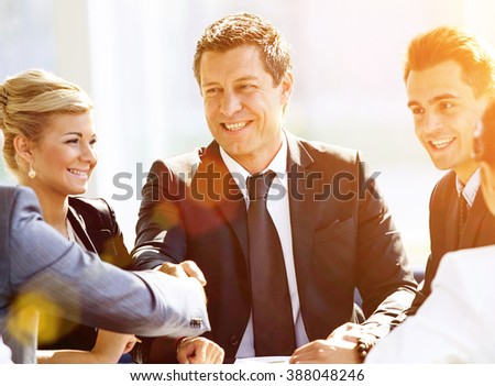 Two businessmen handshaking after striking grand deal - stock photo