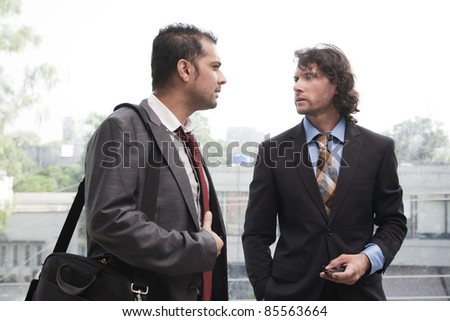two businessmen having a casual discussion - stock photo