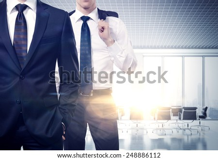 Two businessmen in a contemporary office - stock photo