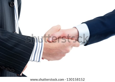 Two businessmen in a handshake isolated on white - stock photo