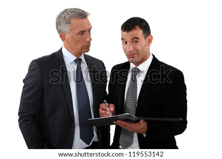 Two businessmen interacting on white background - stock photo