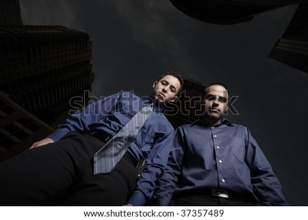 Two businessmen looking downward