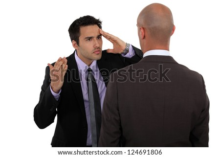 Two businessmen not seeing eye to eye - stock photo