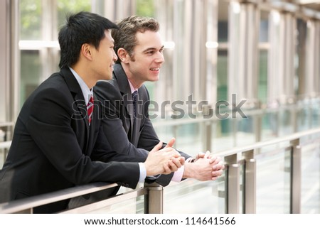 Two Businessmen Outside Modern Office - stock photo