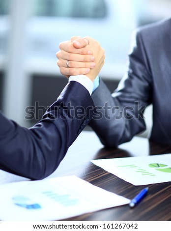 Two businessmen press hands each other on a forward background - stock photo