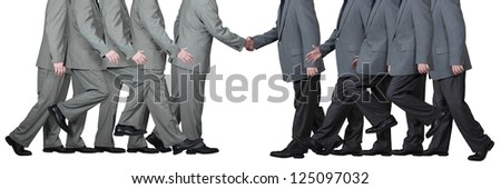 Two businessmen shake hands in agreement and in mutual respect isolated on white - stock photo