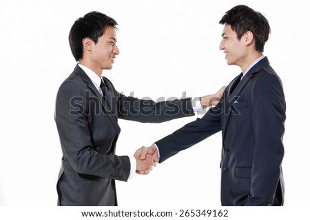two businessmen shaking hands on white background - stock photo