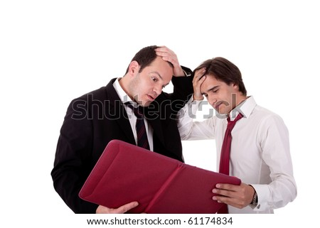 two businessmen talking about work, tired and worried, looking for a document, isolated on a white background - stock photo