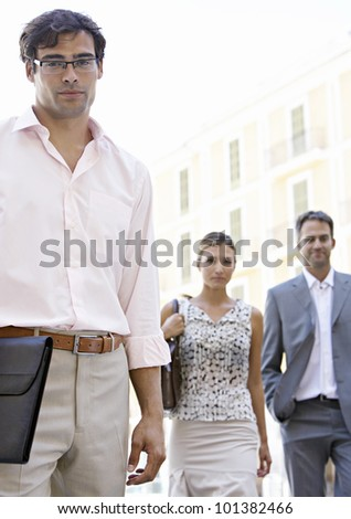 Two businessmen walking in the city. - stock photo