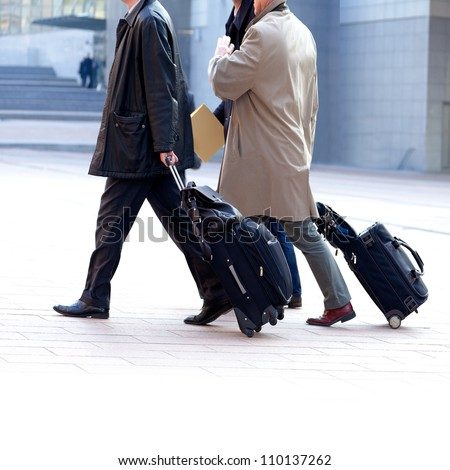 Two businessmen walking on the background of the office. Modern business people. - stock photo