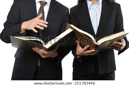 Two businessmen who are studying and reading a difficult book