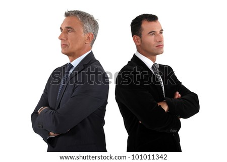Two businessmen with folded arms - stock photo