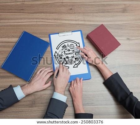 two businesspeople analyzes stock diagram, close up - stock photo
