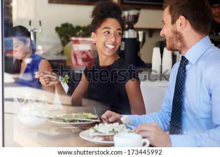 Two Businesspeople Meeting For Lunch In Coffee Shop - stock photo
