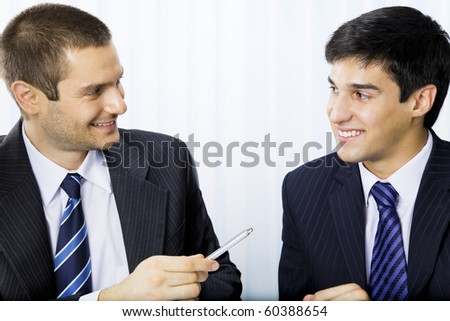 Two businesspeople or client and businessman, giving pen for signing document - stock photo