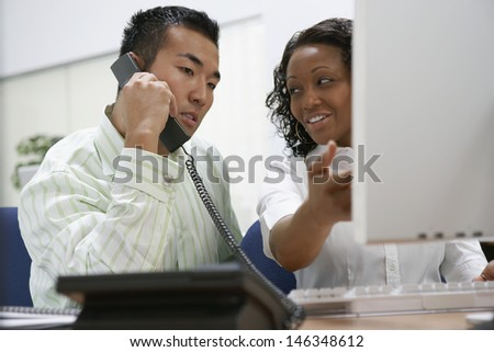 Two businesspeople working at desk