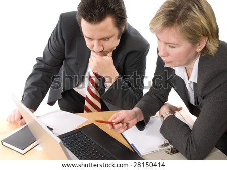 Two businesspeople working at office - stock photo